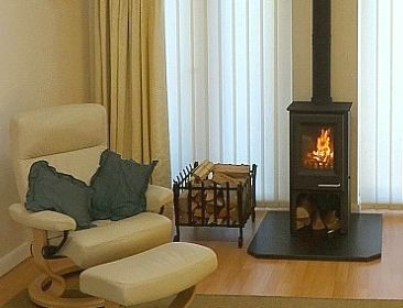 Charnwood Country 4 multifuel freestanding stove fitted with a new chimney liner in a small fireplace near Stamford by Fotheringhay Woodburners.