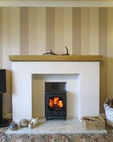 Scan 45 Mini contemporary freestanding stove installed with a chimney liner in a stone fireplace near Oundle by Fotheringhay Woodburners.